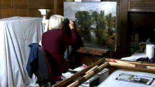 Rosalind Whitehouse working on the painting