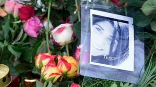 A picture of Tugce and flowers pictured at the grave of Tugce Albayrak