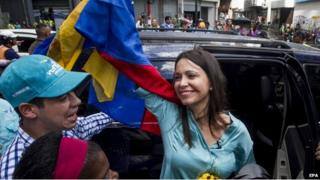 Venezuelan former legislator Maria Corina Machado (C) greets followers after a hearing at Attorney´s Office of Caracas over her alleged responsibility in a plan to kill Venezuelan President Nicolas Maduro, in Caracas, Venezuela, 03 December 2014. Machado