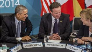 "U.S. President Barack Obama and Britain""s Prime Minister David Cameron listen to Germany""s Chancellor Angela Merkel as they attend the Transatlantic Trade and Investment Partnership (TTIP) meeting at the G20 the G-20 leaders summit in Brisbane, Australia, Sunday, Nov. 16, 2014."