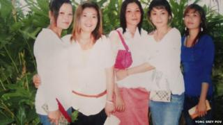 Sam Yin (Extreme left) poses with friends in happier times