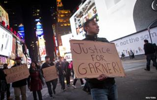 People protest against the Staten Island death of Eric Garner during an arrest in July, at midtown Manhattan in New York December 3, 2014