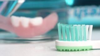 Tooth brush and partial denture