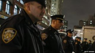 New York City police watch protestors following the announcement that Daniel Pantaleo will not be indicted.
