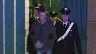 Massimo Carminati being led away by police