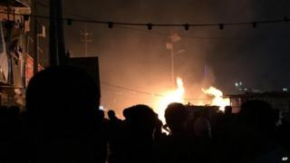 Fires burn after car bombings in Baghdad, 4 Dec