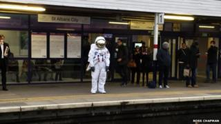 Person dressed as an astronaut at St Albans City Station