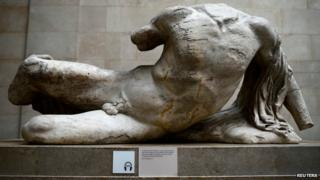 A naked, headless statue, part of a collection of stone objects, inscriptions and sculptures, known as the Elgin Marbles on display in the British Museum