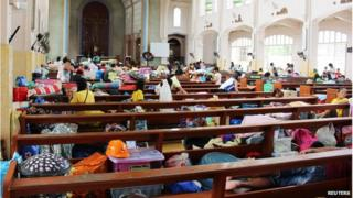 People take shelter inside a church after evacuating their homes due to super-typhoon Hagupit in Tacloban city, central Philippines 5 December 2014
