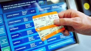 A passenger buying a train ticket