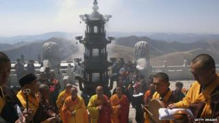 Monks hold a ceremony at a temple on Wutai Mountain