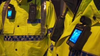 Merseyside Police officers wearing a body camera