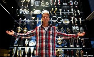 Sebastian Vettel with the trophy cabinet at Red Bull
