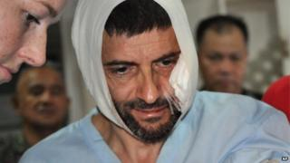 Swiss hostage Lorenzo Vinciguerra, is treated in a hospital following his daring escape from the hands of the Muslim Abu Sayyaf extremists, in Jolo in southern Philippines, Saturday, Dec. 6, 2014