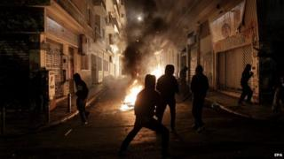 Protesters clash with riot policemen during a rally on the anniversary of the killing of teenager Alexis Grigoropoulos by a Greek police officer, in Athens, Greece, 6 December 2014