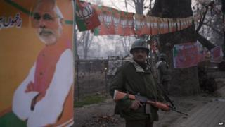 Paramilitary soldiers stand outside Sheri Kashmir cricket stadium where PM Modi is expected to speak on Monday