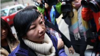 Erwiana Sulistyaningsih arrives at the Wanchai Law Courts to begin giving evidence against her former employer who is accused of abuse and torture in Hong Kong on 8 December 2014.