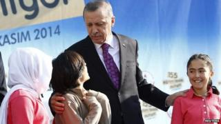 Turkey's President Tayyip Erdogan talks with during a school opening ceremony in Ankara