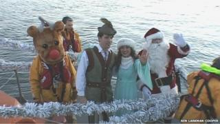Santa and Poole's panto stars arrived by RNLI boat as has been happening in previous years