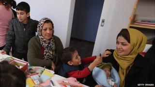 Refugees in Wolgast, Germany - file pic