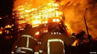 Los Angeles city firefighters battle a massive fire at a seven-storey downtown apartment complex under construction in Los Angeles, California 8 December 2014