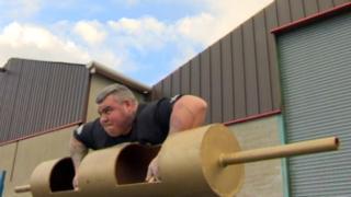 Sean O'Hagan lifts an 18st steel log
