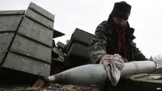A Ukrainian artilleryman prepares shells at their position near the eastern Ukrainian village Pisky, Donetsk region to be fired at the position of pro-Russian separatists at Donetsk airport on December 8, 2014