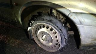 Shredded tyre on van