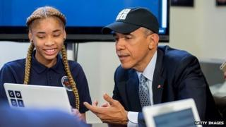 President Obama writing code with school child