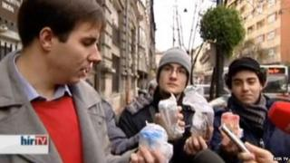 Young Democrats members holding urine samples outside the council building