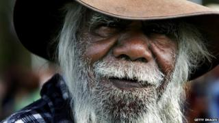 An indigenous Australian arrives to hear Australian Prime Minister Kevin Rudd deliver an apology to the Aboriginal people for injustices committed over two centuries of white settlement at the Australian Parliament on 13 February 2008 in Canberra, Australia