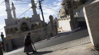 A man walks past a mosque in the Israeli Arab village of Abu Ghosh in Israel