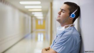 Surgeon listening to music on headphones