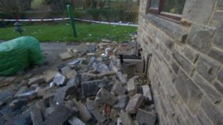 Rubble next to house