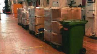 A stack of cardboard boxes in a warehouse