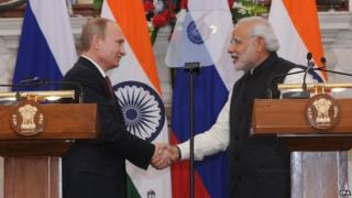 Indian Prime Minister Narendra Modi (R) shakes hands with Russian President Vladimir Putin (L) during a joint media briefing in New Delhi, India on 11 December 2014