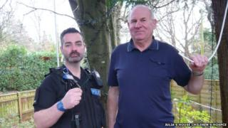 PC Garry Weston and Allan Ward, hospice maintenance officer, with the remaining wire