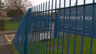 The gates after the crash at Upper Shirley High School