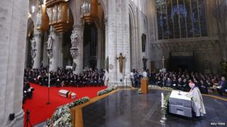 Belgium's Queen Fabiola's coffin is seen inside the cathedral during her funeral service in Brussels