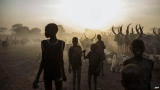 Dinka children with cattle