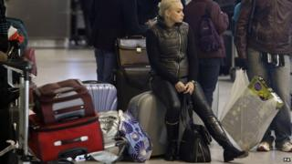 Passengers waiting at Heathrow
