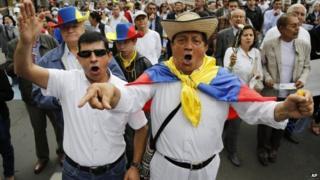 Anti government peace talks march Bogota Dec. 13, 2014.