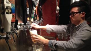 A man serving beer