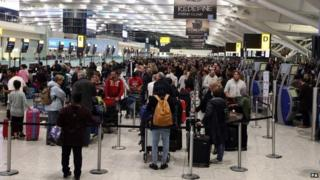 People waiting at Terminal 5 of Heathrow Airport