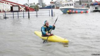 Man in kayak during floods in Ramsey, Isle of Man