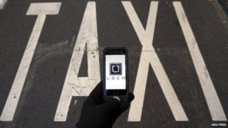 Uber app in front of Taxi road marking