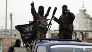 Al-Nusra Front fighters drive through the Idlib countryside on 2 December 2014