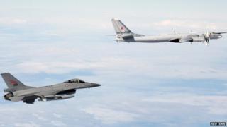 Nato Norwegian F-16 jet/Russian Tu-95 Bear bomber - file pic