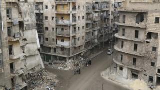 Damaged buildings in Aleppo's al-Shaar district