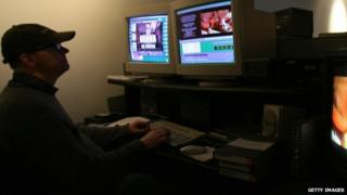 Technician edits pornographic movie at the Vivid Entertainment studio in Los Angeles. 30 January 2007